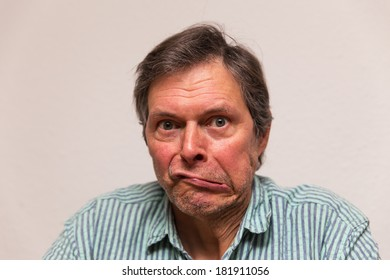 funny senior citizen is making a grimace