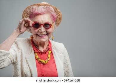 Funny senior lady looking at camera