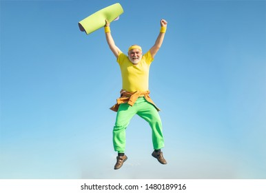 Funny Senior man Jumping. Old man jumping on blue sky background.