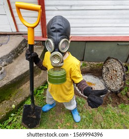 Funny septic pumper in gas mask and protective uniform standing with big shovel in his hands. Stinky overflowing sewer on the background.