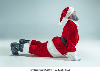 dc5a5f1b668eb Funny serious guy with christmas hat dancing at studio. New Year Holiday.  Christmas