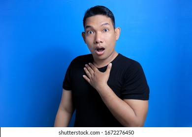 Funny shocked and appalled face of Asian man