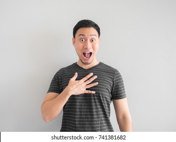 Funny shocked and surprised face on Asian man.