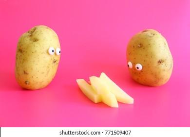 Funny shoked potatoes looking at chips