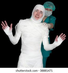 Funny sick in bandage and nurse isolated on black background