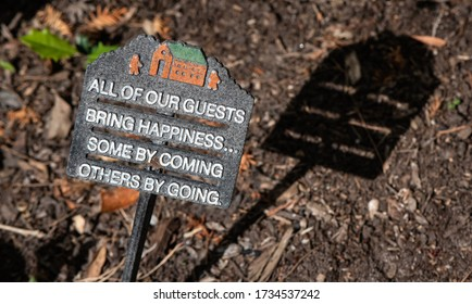 Funny sign about guests coming and going.