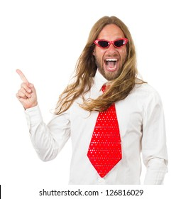 Funny and silly portrait of a hippie man in a bright tie and retro sunglasses pointing at copy space. Isolated on white.
