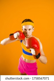 Funny skinny boxer man with red boxing gloves.
