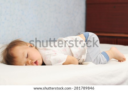 Funny sleep baby bottom up. Little kid sleeping cute with the fanny up. Child