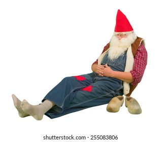 Funny sleeping garden gnome with holes in his socks