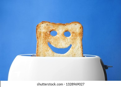 Funny slice of bread with toaster on color background