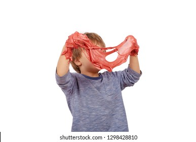 Funny small boy entangled slime. Isolated on white background