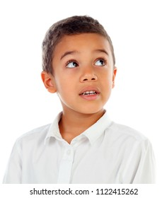 Funny small child with dark hair and black eyes crossing his arms isolated on a white background