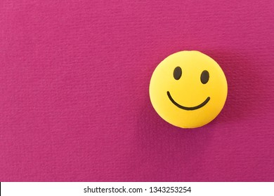 Funny smiley face on purple background. Positive mood. Empty text space