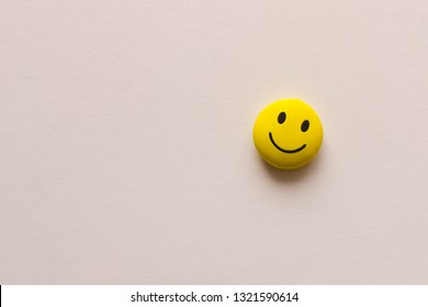 Funny smiley face on white background. The concept of positive mood. Empty text space.