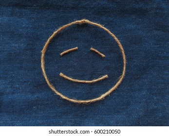 Funny smiley of twine in denim