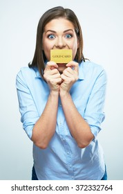Funny smiling business woman hold credit card. White background isolated.