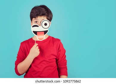 funny and smiling child on blue background