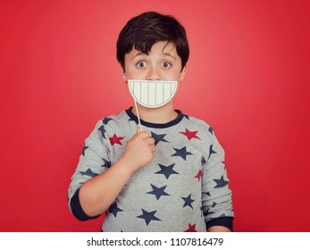 funny and smiling child on red background