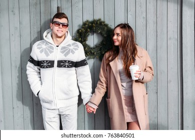 Funny smiling couple in love posing on the street in winter cold weather