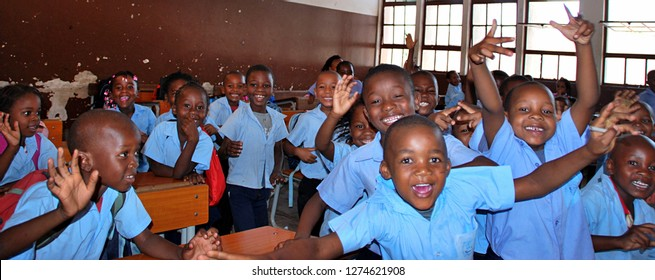 Funny, smiling and happy children in a school of a third world country. Maputo, Mozambique, Africa.  8th November 2017