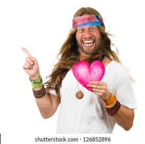 Funny, smiling hippie man holding a love heart and pointing up at copy-space. Isolated on white.