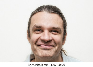 Funny smiling man looking at camera on white background, retro toned