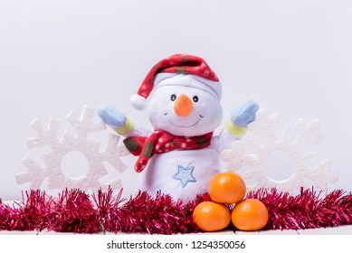 Funny snowman with big snowflakes from foam on a white wooden background