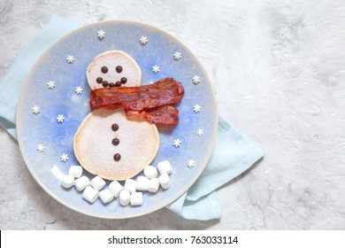 Funny snowman Christmas morning breakfast pancakes and bacon for kids