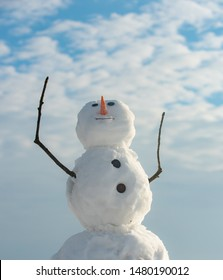 Funny snowman in stylish hat and scarf on snowy field. Snowman wish you merry Christmas. Handmade snowman in the snow outdoor. Snowman and snow day