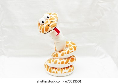 Funny soft snake toy isolated on white background.