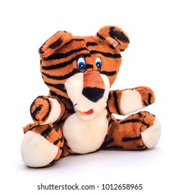 Funny soft toy striped orange tiger on white background, isolate
