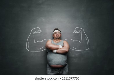Funny sports nerd with huge arms drawn on the gray background with copy space
