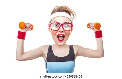 Funny sports woman with dumbbell, close-up of fitness girl