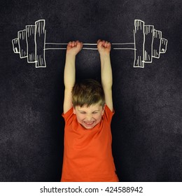 Funny strong child with drawn barbell.