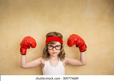 Funny strong child. Girl power and feminism concept