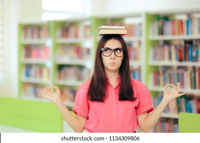 Funny Student Balancing Books Over her Head in a Library Cute academic girl managing anxiety before important exams
