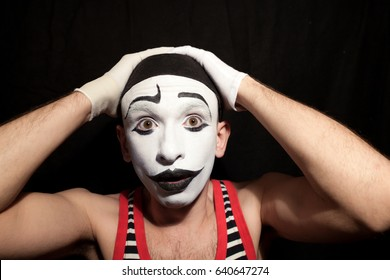 A funny stupid mime grabbed his head
