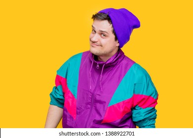 Funny style white man in 90s jacket and hat on yellow background
