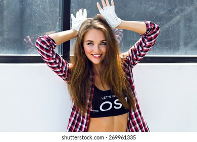 Funny summer fashion lifestyle portrait of amazing pretty young woman with freckles, bright sexy make up and fluffy long hairs, hipster girl having fun, imitate bunny ears.