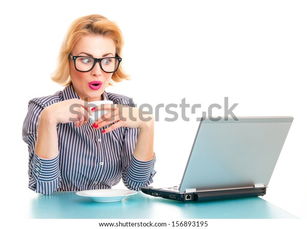 Funny surprised business woman watching in laptop, isolated on white