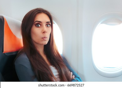 Funny Surprised Woman Sitting By the Window on An Airplane - Aircraft passenger feeling excited for the flight