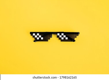 Funny swag pixilated boss sunglasses on yellow background. Gangster, Black thug life meme glasses. Pixel 8bit style