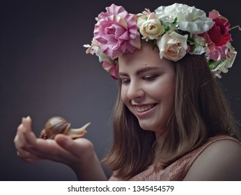 Funny teen with his snail pal. Female portrait