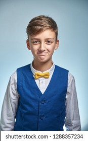 Funny teenager boy in a shirt with a butterfly tie