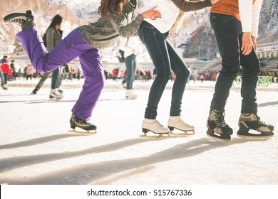 Funny teenagers girls and boy skating outdoor, ice rink
