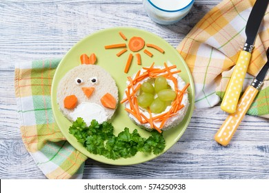 Funny toast in a shape of chick and nest with eggs, sandwich for kids Easter idea, top view