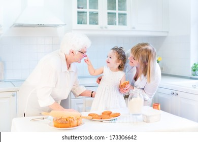 Funny toddler girl playing in a kitchen, having fun baking an apple pie with her grandmothers