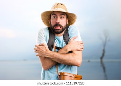Funny tourist freezing in a beautiful landscape