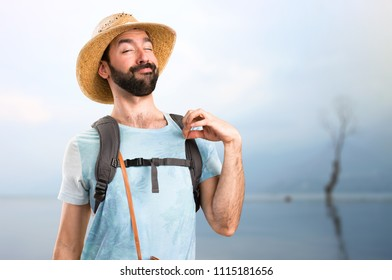 Funny tourist proud of himself in a beautiful landscape